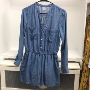 Chambray romper with functional buttons.